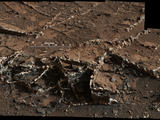 "This March 18, 2015, view from the Mast Camera on NASA's Curiosity Mars rover shows a network of two-tone mineral veins at an area called ""Garden City"" on lower Mount Sharp."