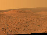 This vista from NASA's Mars Exploration Rover Opportunity shows Wdowiak Ridge, from left foreground to center, as part of a northward look with the rover's tracks visible at right.