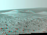 This stereo vista from NASA's Mars Rover Opportunity shows Wdowiak Ridge, from left foreground to center, as part of a northward look. The image combines Sept. 17, 2014, views from the left eye and right eye of Opportunity's Pancam to appear three-dimensional when seen through blue-red glasses.