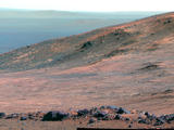 "This view from NASA's Opportunity Mars rover shows part of ""Marathon Valley"" as seen from an overlook north of the valley. It was taken by the rover's Pancam on March 13, 2015. This version is presented in false color to make differences in surface materials more easily visible."