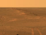 read the article 'Mars Rover Opportunity's Vista Includes Long Tracks'