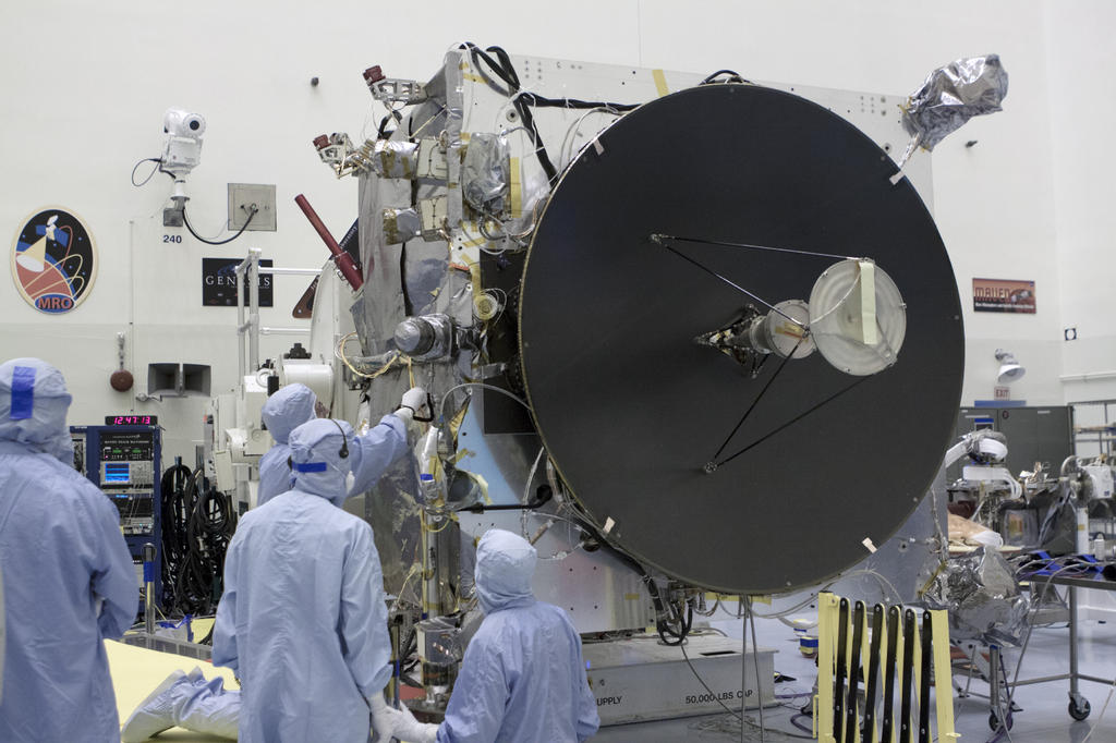 Engineers work on the MAVEN spacecraft, which is dominated by the high-gain antenna that is crucial to communications with NASA's Deep Space Network.