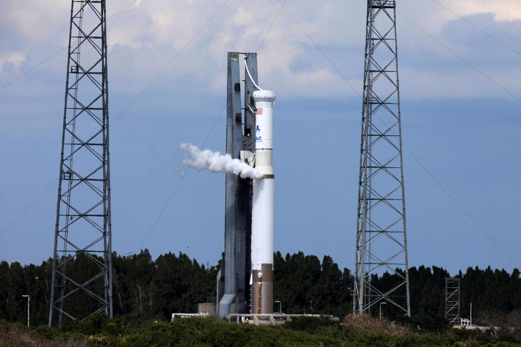 "The United Launch Alliance Atlas V rocket stands at Launch Complex 41 on Cape Canaveral Air Force Station in Florida during a ""wet dress rehearsal."""