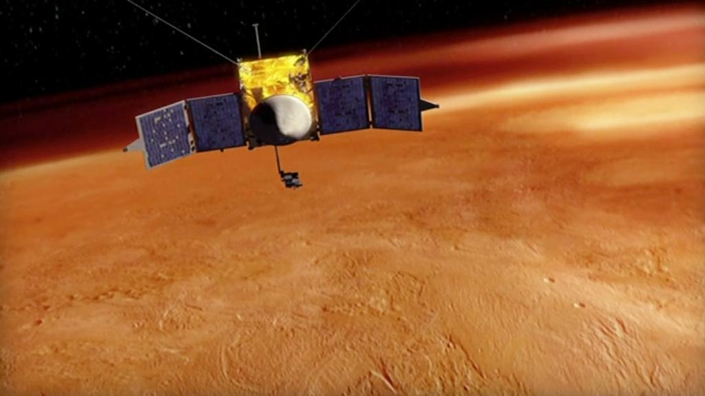This artist's concept depicts NASA's Mars Atmosphere and Volatile EvolutioN (MAVEN) spacecraft orbiting Mars.