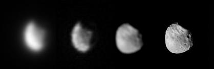 This sequence of images shows the rough outline of Phobos, fuzzy on the left, becoming gradually sharper in two successive images to the right. The fourth image, on the far right, is a much closer image taken from orbit around Mars by the Mars Express. It shows a bumpy, crater surface, with a circular portion missing from the upper right limb.