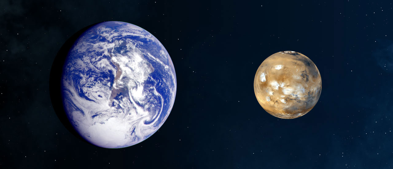 Earth and Mars (to scale)