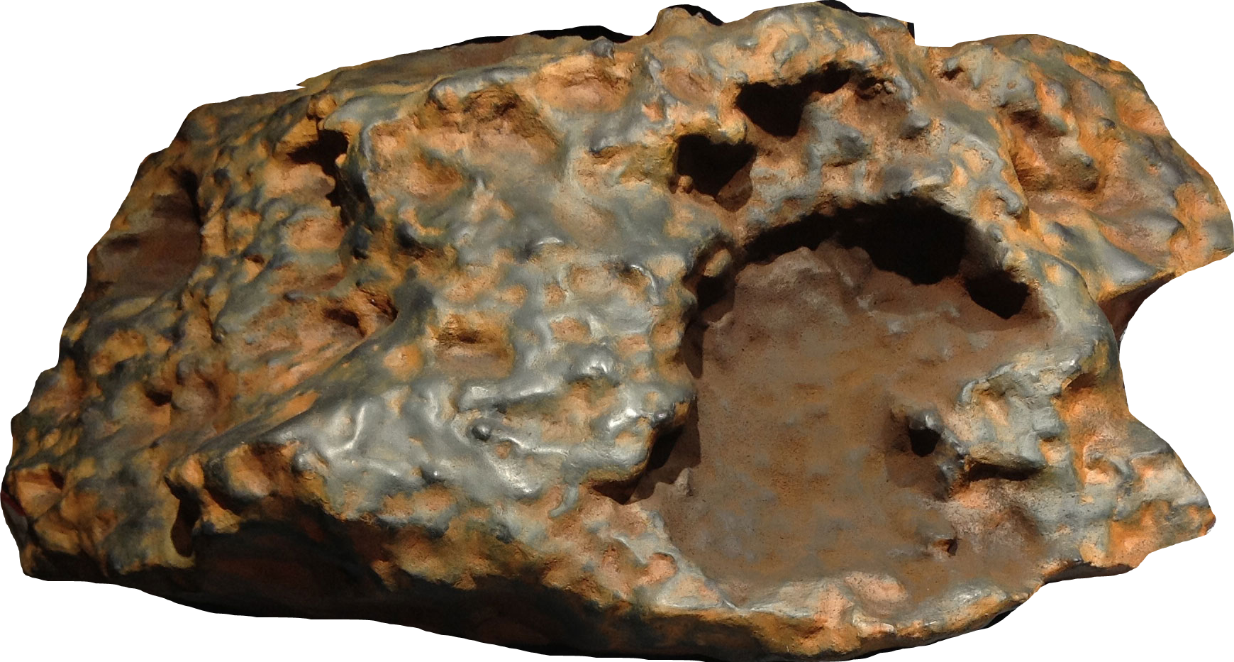 Download 3D Print File for 'Block Island' Meteorite. This is a color image of the 3D model of the Block Island meteorite, which is about the size of a microwave oven. The meteorite is oddly shaped and is a dark brown color with some touches of dark orange. The right side of the meteorite has a chunk missing and has a darker, smoother surface.