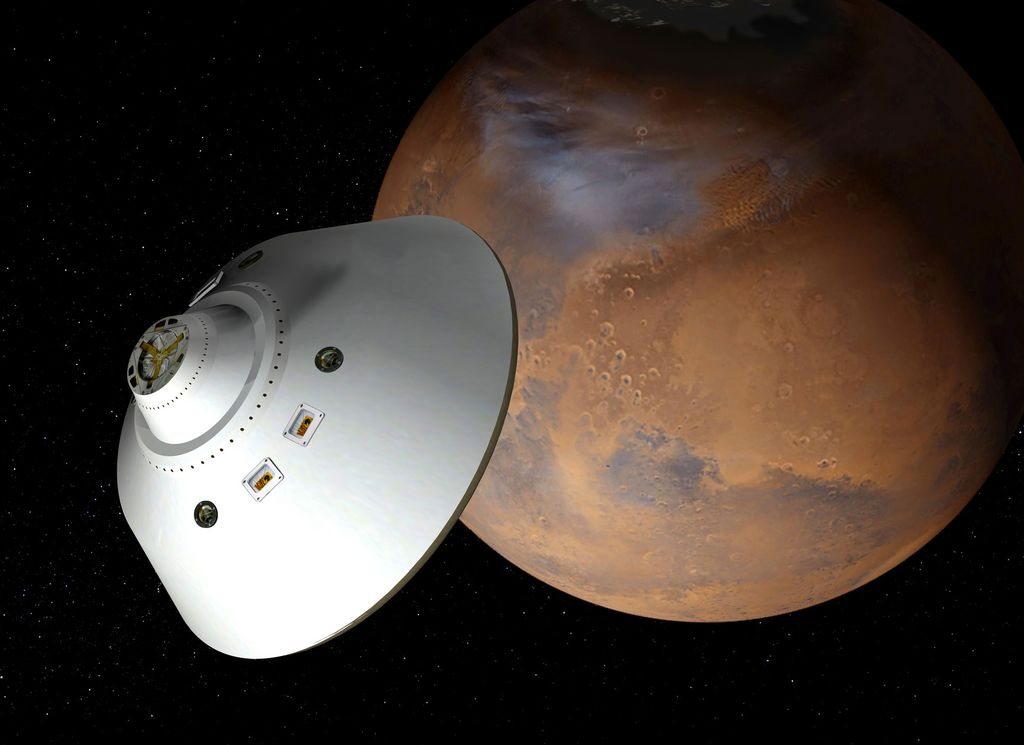 This artist's concept of a proposed Mars sample return mission portrays an aeroshell-encased spacecraft approaching Mars.