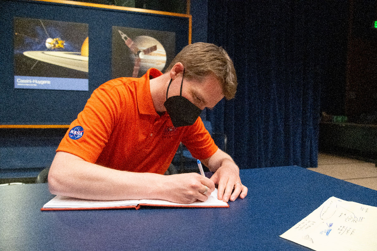 "Ingenuity Mars chief pilot Håvard Grip records data of the first flight of the Ingenuity Mars Helicopter into the official pilot's logbook for the project – the ""Nominal Pilot's Logbook for Planets and Moons."""
