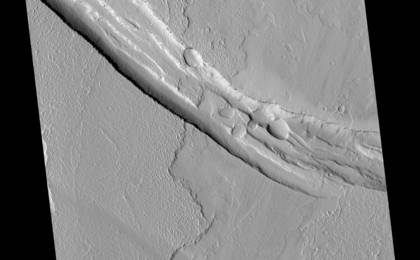 see the image 'Graben Cutting Lava Flow in Tharsis'
