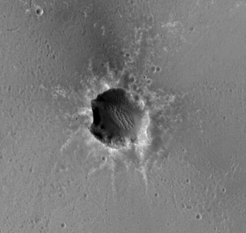 "The High Resolution Imaging Science Experiment (HiRISE) camera on NASA's Mars Reconnaissance Orbiter acquired this image of the Opportunity rover on the southwest rim of ""Santa Maria"" crater on New Year's Eve 2010, or Martian day (sol) 2466 of the rover's work on Mars."