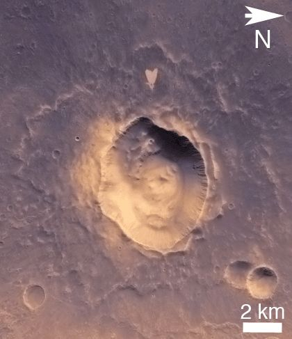 This picture of a heart-shaped feature in Arabia Terra on Mars was taken on May 23, 2010, by the Context Camera (CTX) on NASA's Mars Reconnaissance Orbiter.