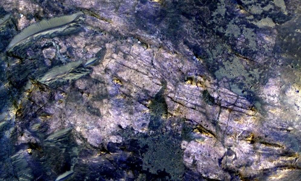 This image from orbit covers an area about 460 meters (about 1,500 feet) across, in which carbonate minerals have been identified from spectrometer observations. Fractures and possible layers are visible in the light-toned rock exposure containing the carbonates.