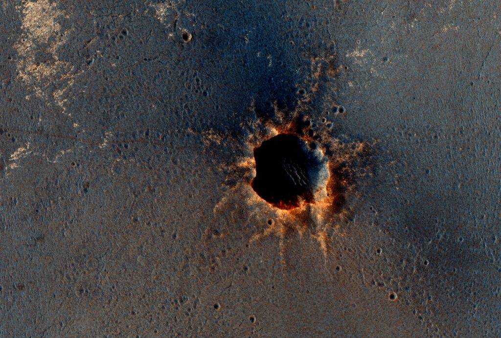 "The High Resolution Imaging Science Experiment (HiRISE) camera on NASA's Mars Reconnaissance Orbiter acquired this color image on March 9, 2011, of ""Santa Maria"" crater, showing NASA's Mars Exploration Rover Opportunity perched on the southeast rim."