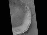 This image contrasts gullies and recurring warm-season slope flows appearing in the same crater, in the middle southern latitudes of Mars.