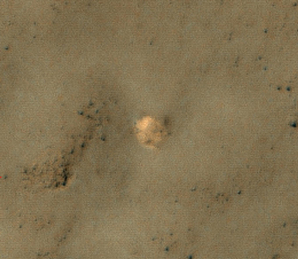 The bright feature in this image might be the parachute from a 1971 Soviet Mars lander named Mars 3. The image was taken by the High Resolution Imaging Science Experiment (HiRISE) camera on NASA's Mars Reconnaissance Orbiter.
