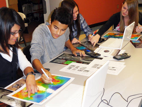 Ninth-grade, high-school students from Peoria, AZ analyze images of Mars.