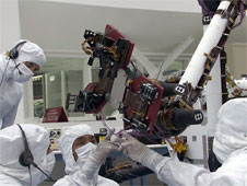 This video clip shows engineers in the JPL clean room giving the rover lessons in hand-eye coordination.