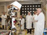 A group watching motions of an engineering model of the camera mast for NASA's Mars rover Curiosity on March 5, 2010, includes moviemaker James Cameron (right).