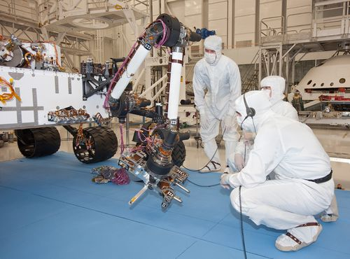 Test operators in a clean room at NASA's Jet Propulsion Laboratory, Pasadena, Calif., monitor some of the first motions by the robotic arm on the Mars rover Curiosity after installation in August 2010.