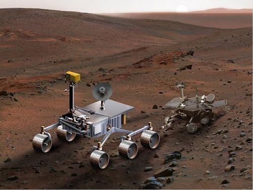 An artist's concept of NASA's Mars Science Laboratory (left) serves to compare it with Spirit, one of NASA's twin Mars Exploration Rovers.