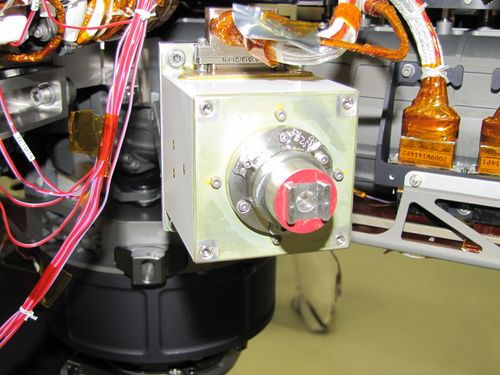 The sensor head on the Alpha Particle X-ray Spectrometer instrument was installed during testing at NASA's Jet Propulsion Laboratory. The instrument is part of the Curiosity rover, which will fly on NASA's Mars Science Laboratory mission. For perspective, the sensor head is 7.8 centimeters, or about 3 inches tall.