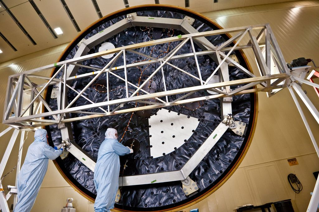 Technicians at Lockheed Martin Space Systems, Denver, prepare the heat shield for NASA's Mars Science Laboratory, in this April 2011 photo. With a diameter of 4.5 meters (nearly 15 feet), this heat shield is the largest ever built for a planetary mission.