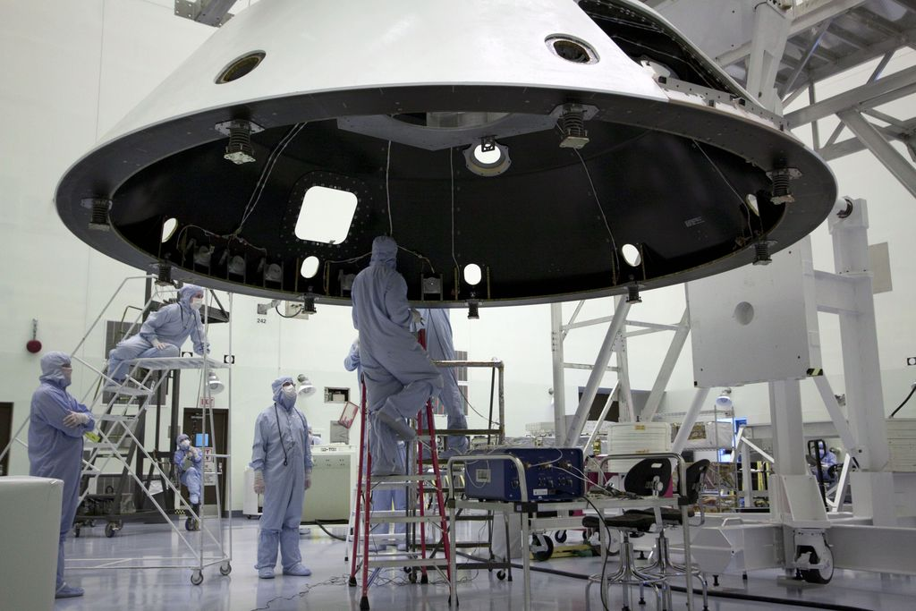 At the Payload Hazardous Servicing Facility at NASA's Kennedy Space Center in Florida, technicians process the backshell for NASA's Mars Science Laboratory (MSL).