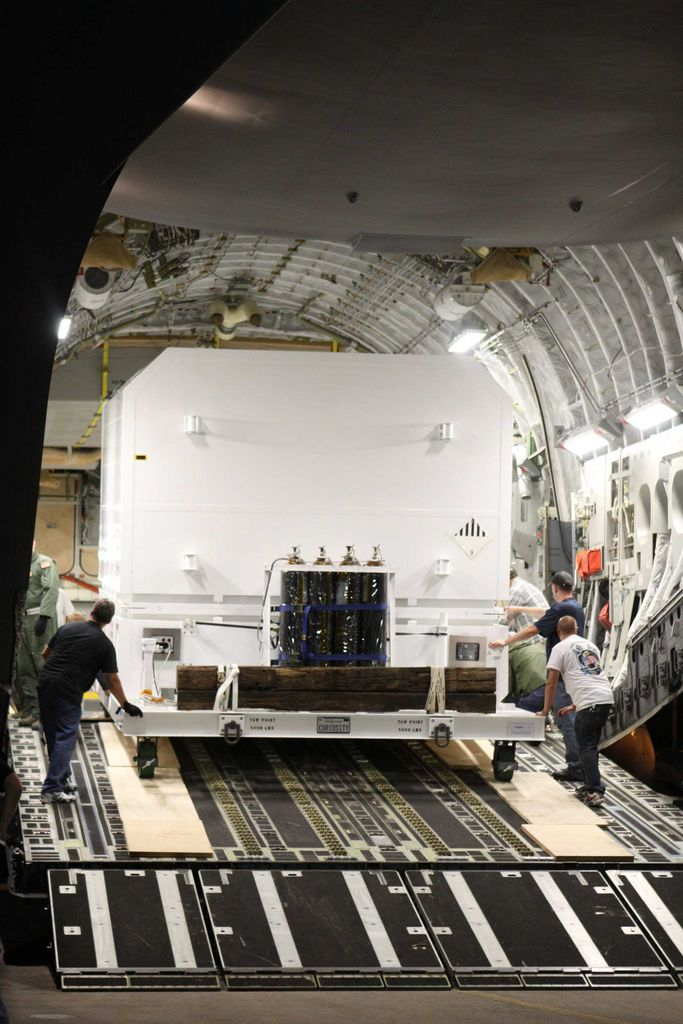A photo of the Curiosity rover being unloaded from a C-17 transport plane.