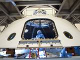 In the Payload Hazardous Servicing Facility at NASA's Kennedy Space Center in Florida, technicians process the backshell for NASA's Mars Science Laboratory (MSL).