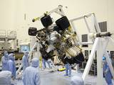 Technicians in the Payload Hazardous Servicing Facility at NASA's Kennedy Space Center in Florida put NASA's Mars Science Laboratory (MSL) rover, known as Curiosity, through a series of rotation tests.