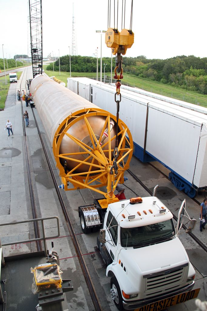 A crane is attached to the first stage of the Atlas V rocket for NASA's Mars Science Laboratory (MSL) mission upon its arrival at the Vertical Integration Facility at Space Launch Complex 41 on Cape Canaveral Air Force Station.