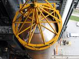 A crane positions the 106.5-foot-long first stage of the Atlas V rocket for NASA's Mars Science Laboratory (MSL) mission inside the Vertical Integration Facility at Space Launch Complex 41 on Cape Canaveral Air Force Station.