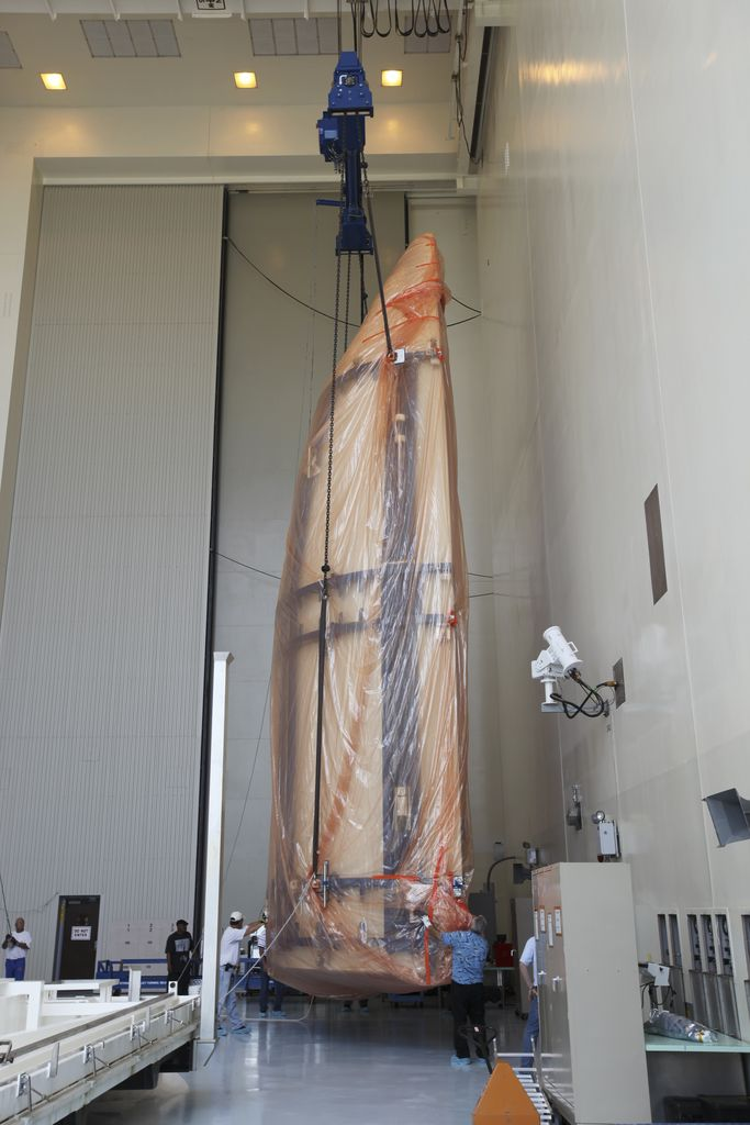 Half of the Atlas V payload fairing for NASA's Mars Science Laboratory (MSL) mission is lifted into a vertical position in the airlock of the Payload Hazardous Servicing Facility at NASA's Kennedy Space Center in Florida.