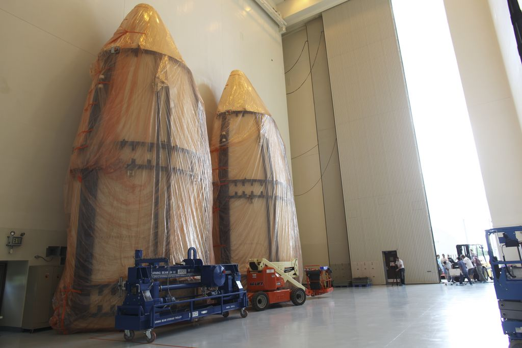 The dual sections of the Atlas V payload fairing for NASA's Mars Science Laboratory (MSL) mission await further processing in the airlock of the Payload Hazardous Servicing Facility at NASA's Kennedy Space Center in Florida.