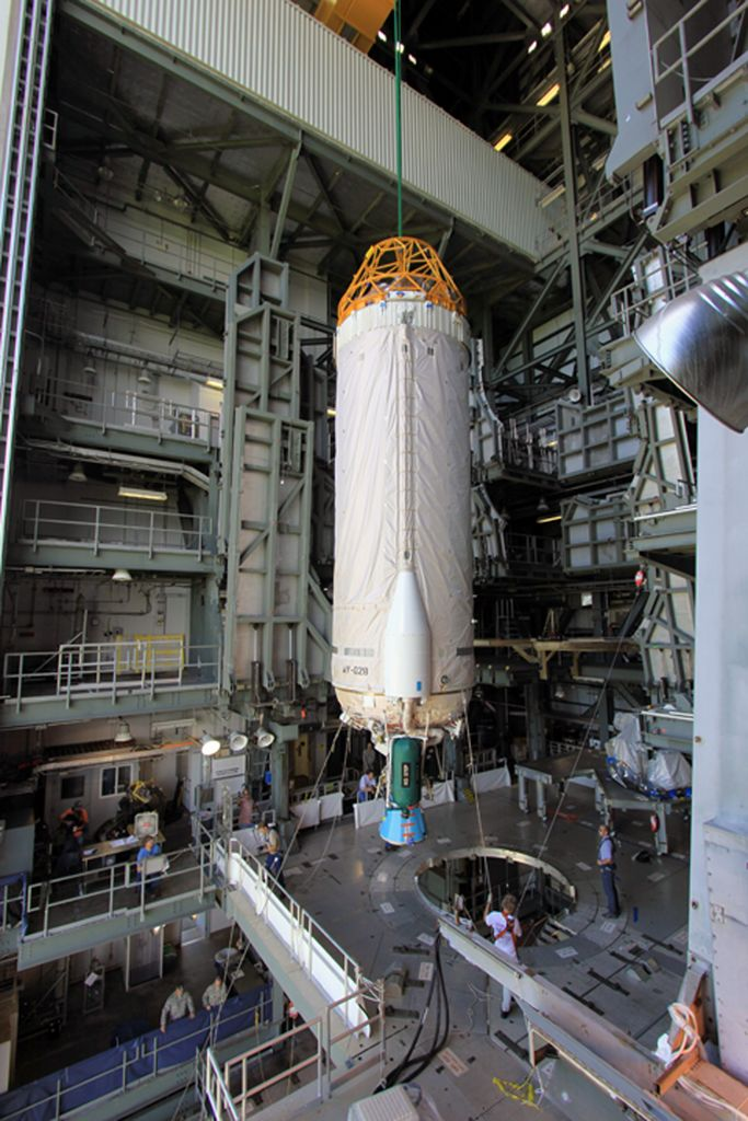 At Launch Complex 41 at Cape Canaveral Air Force Station in Florida, workers guide an overhead crane as it lifts the Centaur upper stage for the United Launch Alliance Atlas V in the Vertical Integration Facility (VIF).