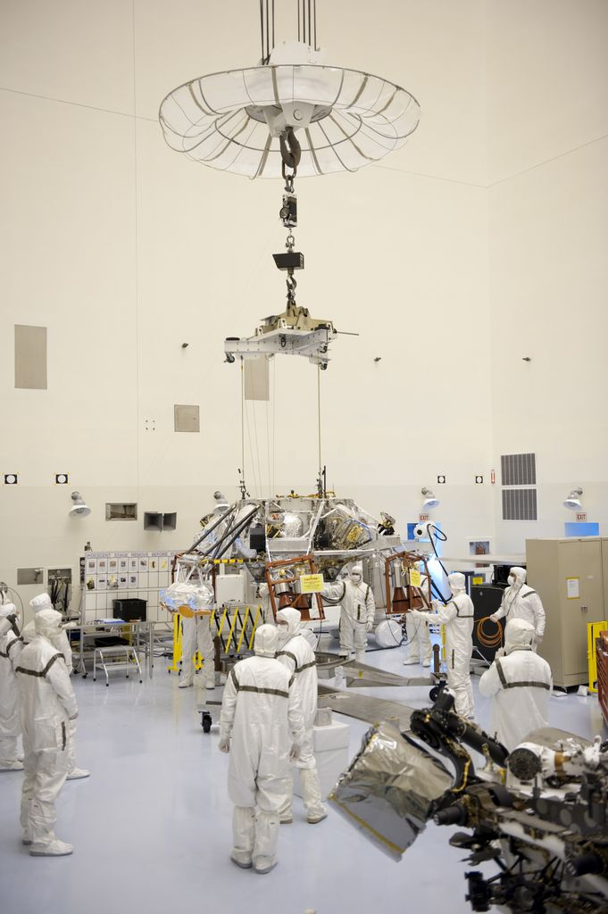 Technicians, at the Payload Hazardous Servicing Facility at NASA's Kennedy Space Center in Florida, use an overhead crane to move a rocket-powered descent stage for integration with NASA's Mars Science Laboratory (MSL) rover, known as Curiosity.