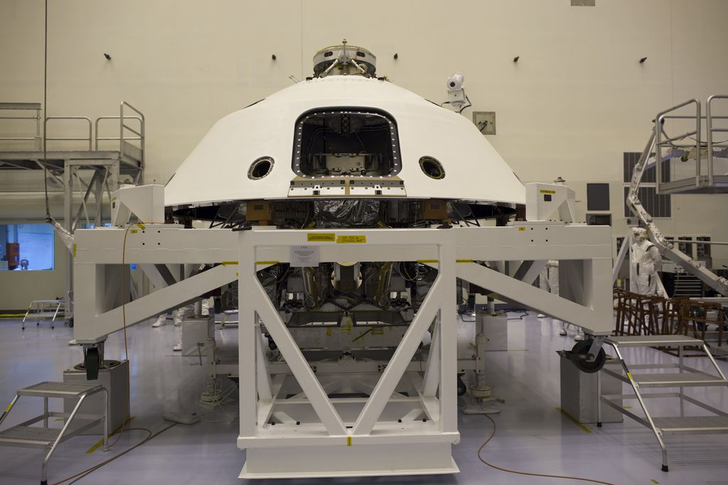 In the Payload Hazardous Servicing Facility at NASA's Kennedy Space Center in Florida, the backshell, a protective cover which carries the parachute and several components used during later stages of entry, descent and landing, has been encapsulated over NASA's Mars Science Laboratory (MSL) rover, Curiosity.