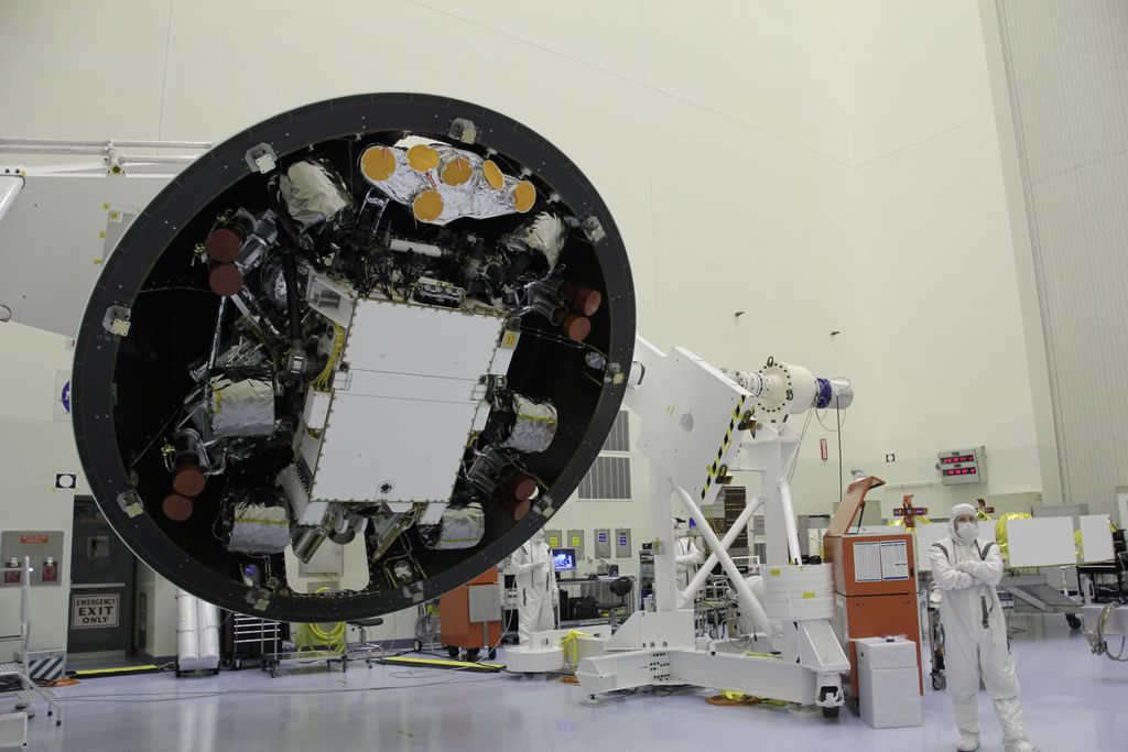 "At the Payload Hazardous Servicing Facility at NASA's Kennedy Space Center in Florida, the ""back shell powered descent vehicle"" configuration of NASA's Mars Science Laboratory is being rotated for final closeout actions."