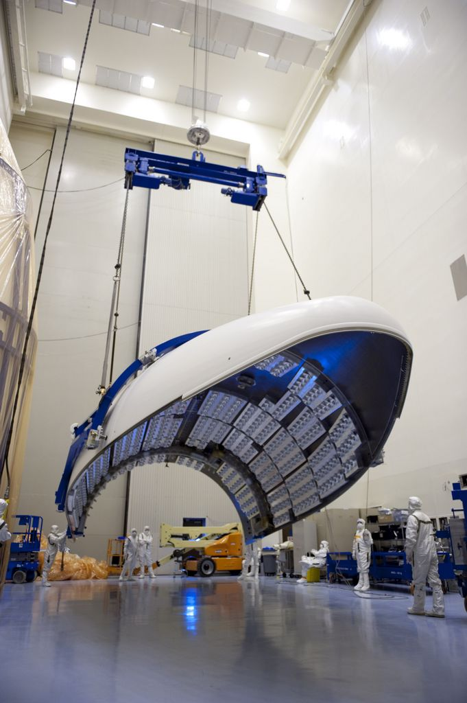 In the Payload Hazardous Servicing Facility at NASA's Kennedy Space Center in Florida, the fairing acoustic protection (FAP) system lining the inside of the Atlas V payload fairing for NASA's Mars Science Laboratory (MSL) mission comes into view as the fairing is lifted into a vertical position.