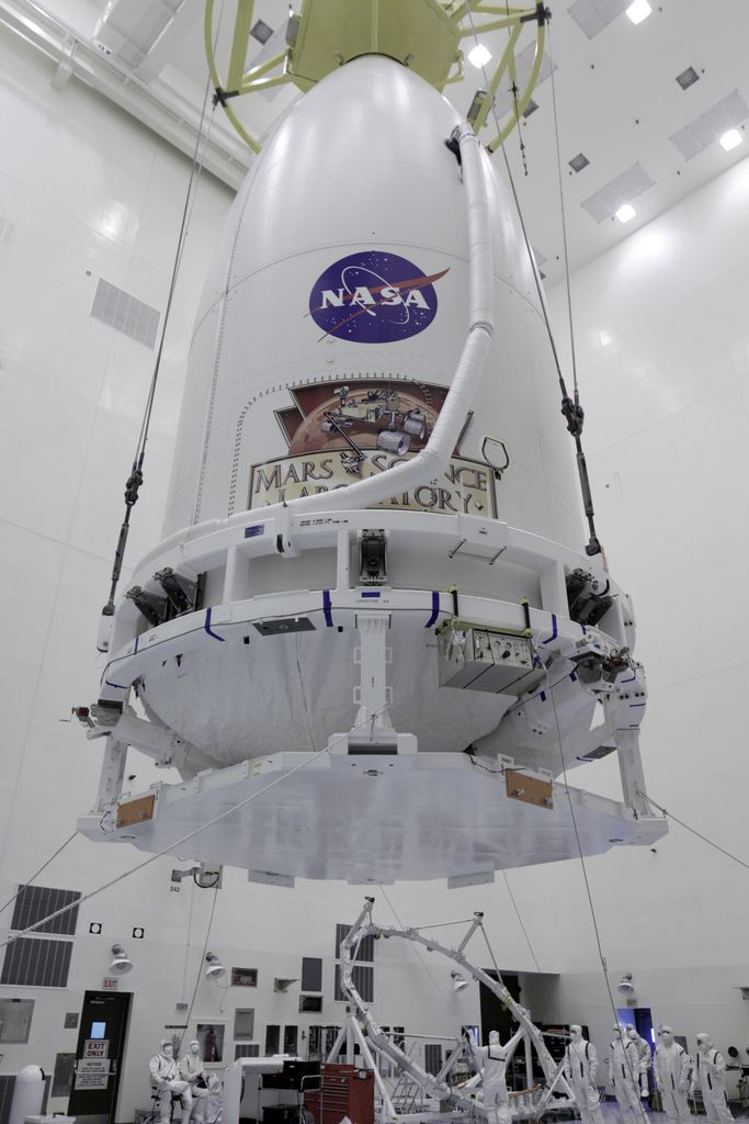 The Atlas V payload fairing containing NASA's Mars Science Laboratory (MSL) spacecraft rises above the floor of the Payload Hazardous Servicing Facility at Kennedy Space Center in Florida.
