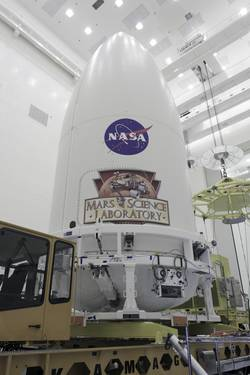 In the Payload Hazardous Servicing Facility at NASA's Kennedy Space Center in Florida, the Atlas V rocket's payload fairing containing the Mars Science Laboratory (MSL) spacecraft stands securely atop the transporter that will carry it to Space Launch Complex 41.