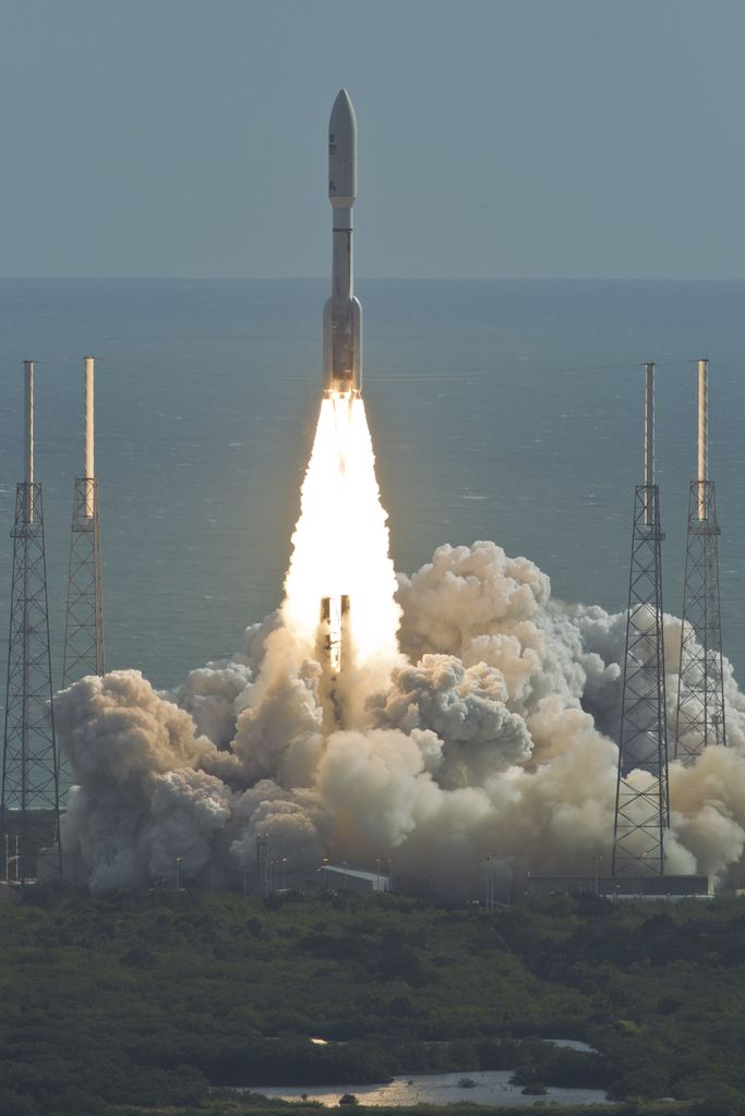 With NASA's Mars Science Laboratory (MSL) spacecraft sealed inside its payload fairing, the United Launch Alliance Atlas V rocket rides smoke and flames as it rises from the launch pad at Space Launch Complex-41 on Cape Canaveral Air Force Station in Florida at 10:02 a.m. EST Nov. 26.
