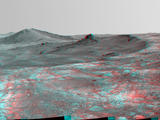 "An elongated crater called ""Spirit of St. Louis,"" with a rock spire in it, dominates this stereo view from NASA's Mars Exploration Rover Opportunity."