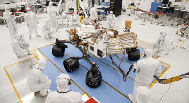 Technicians and engineers in clean-room garb monitor the first drive test of NASA's Mars Science Laboratory, also known as the Curiosity rover, on July 23, 2010.