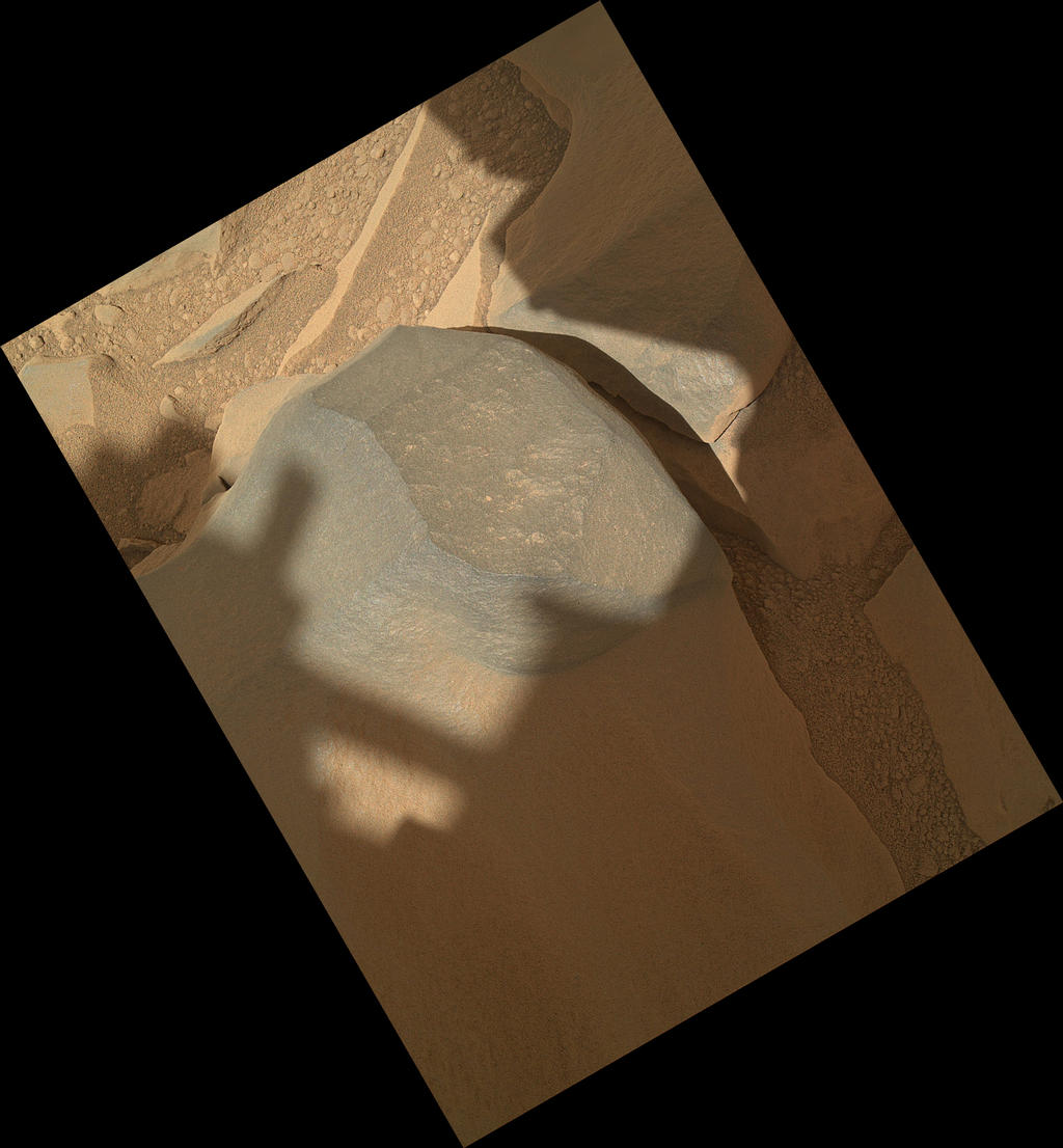"NASA's Mars rover Curiosity held its Mars Hand Lens Imager (MAHLI) camera about 10.5 inches (27 centimeters) away from the top of a rock called ""Bathurst Inlet"" for a set of eight images combined into this merged-focus view of the rock."