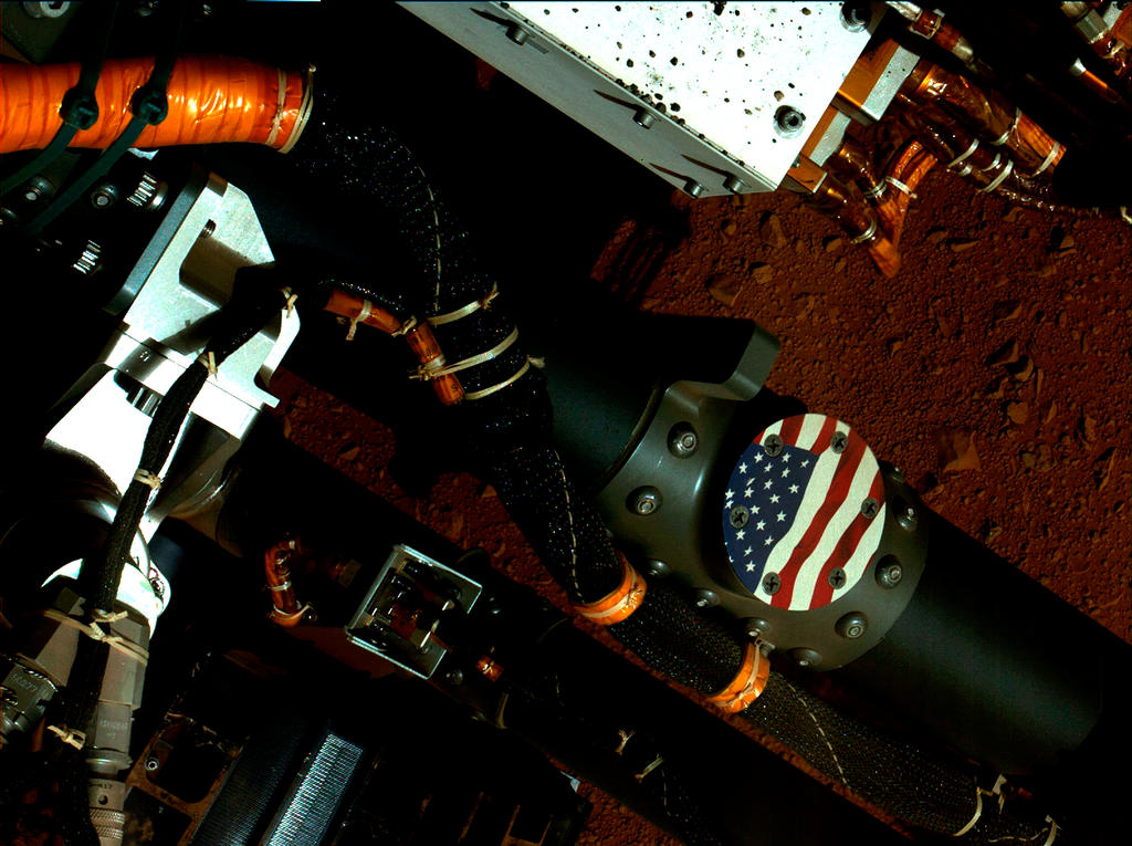 This view of the American flag medallion on NASA's Mars rover Curiosity was taken by the rover's Mars Hand Lens Imager (MAHLI) during the 44th Martian day, or sol, of Curiosity's work on Mars (Sept. 19, 2012).