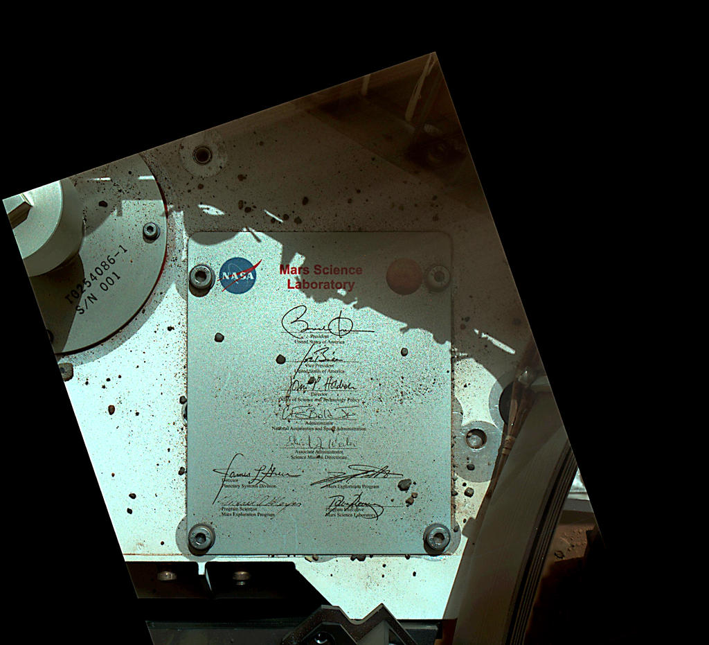 This view of Curiosity's deck shows a plaque bearing several signatures of US officials, including that of President Obama and Vice President Biden.