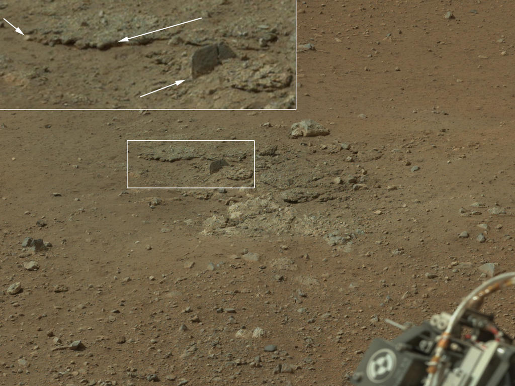 This color image from NASA's Curiosity rover shows an area excavated by the blast of the Mars Science Laboratory's descent stage rocket engines