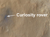 read the article 'Orbiter Views NASA's New Mars Rover In Color'